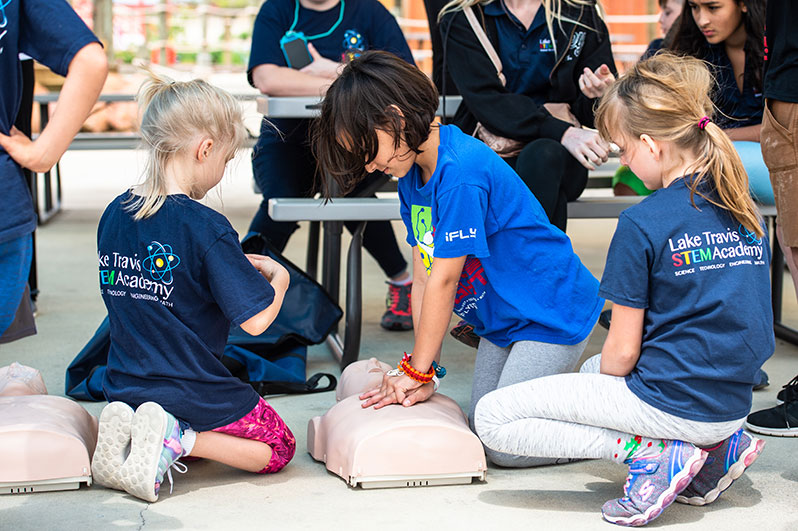 Children at LTSA are learning CPR procedures in a hands-on approach