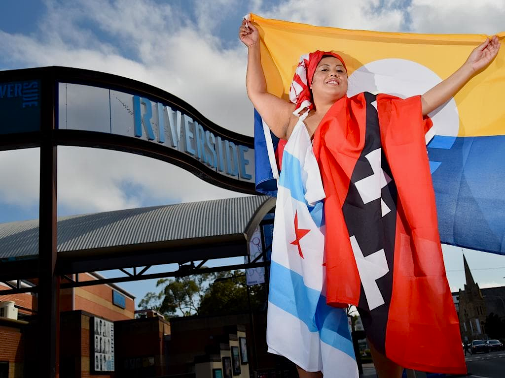 Ballina Gee  @PacificDiva  launching the Unofficial Exhibit #1, wearing Amsterdam, Chicago and Milwaukee Peoples Flags. Photo courtesy of Parramatta Advertiser.