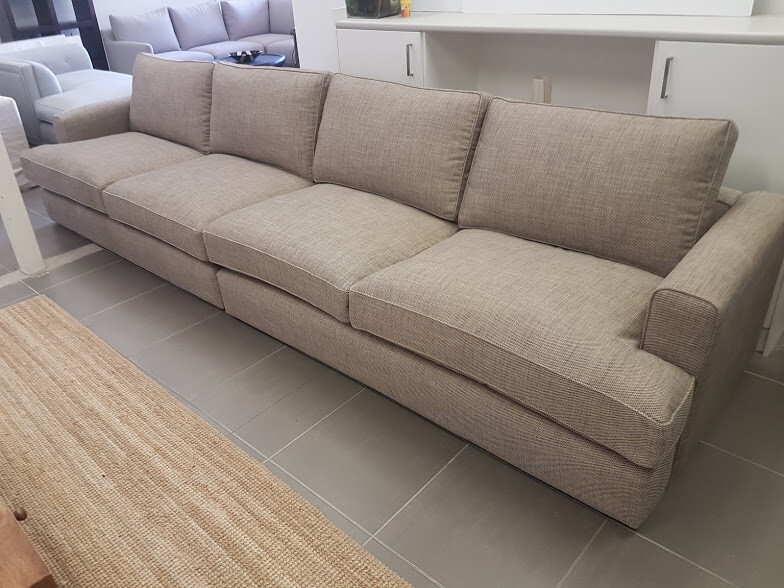 Bespoke T-cushion sectional Oscar with self pipe.  Lisa Stein Interiors