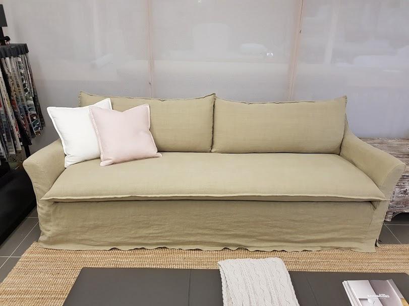 Splayed arm slip cover sofa pair
