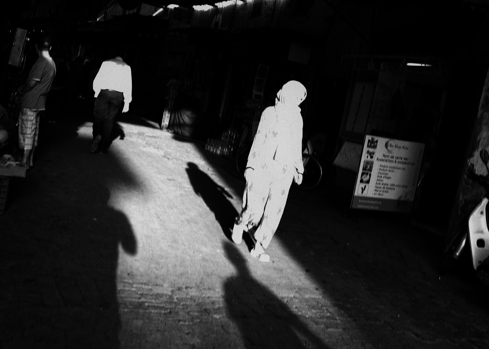 For this image, I carefully set my aperture and shutter speed in order to over-expose the woman and darken the surroundings. The extreme high contrast results in a dramatic image.