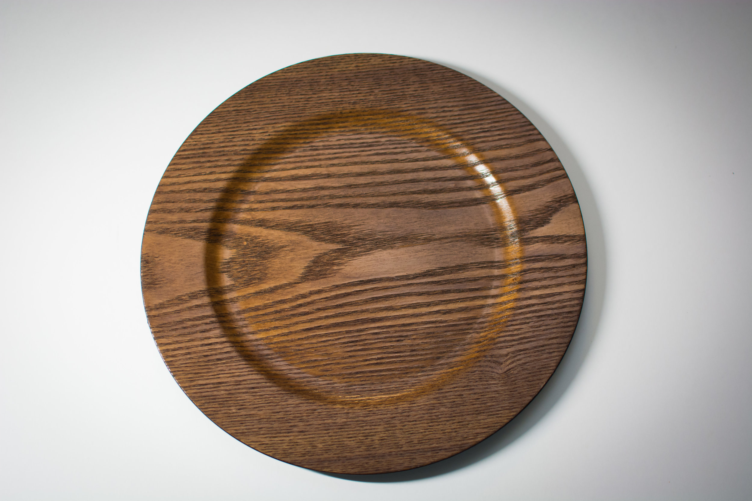 Walnut charger plate   Material: acrylic  $2.00 Per Plate  Inquire about quantity and availability