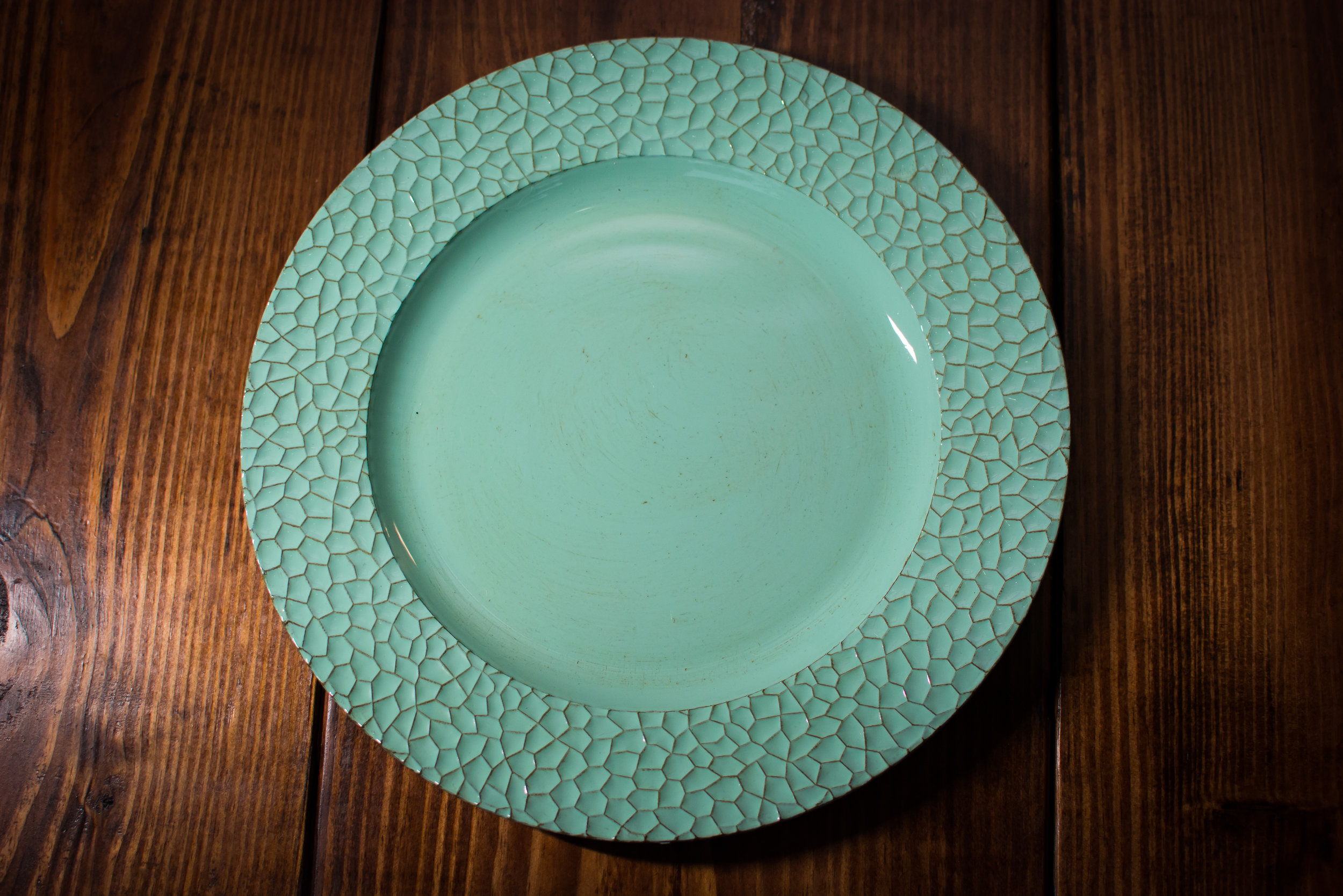 teal charger plate   Material: acrylic  $1.50 Per Plate  Inquire about quantity and availability