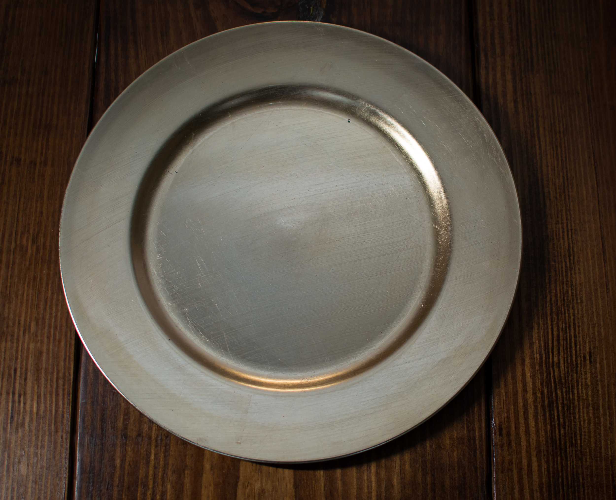 Gold charger plate   Material: Acrylic  $1.00 Per Plate  Inquire about quantity and availability