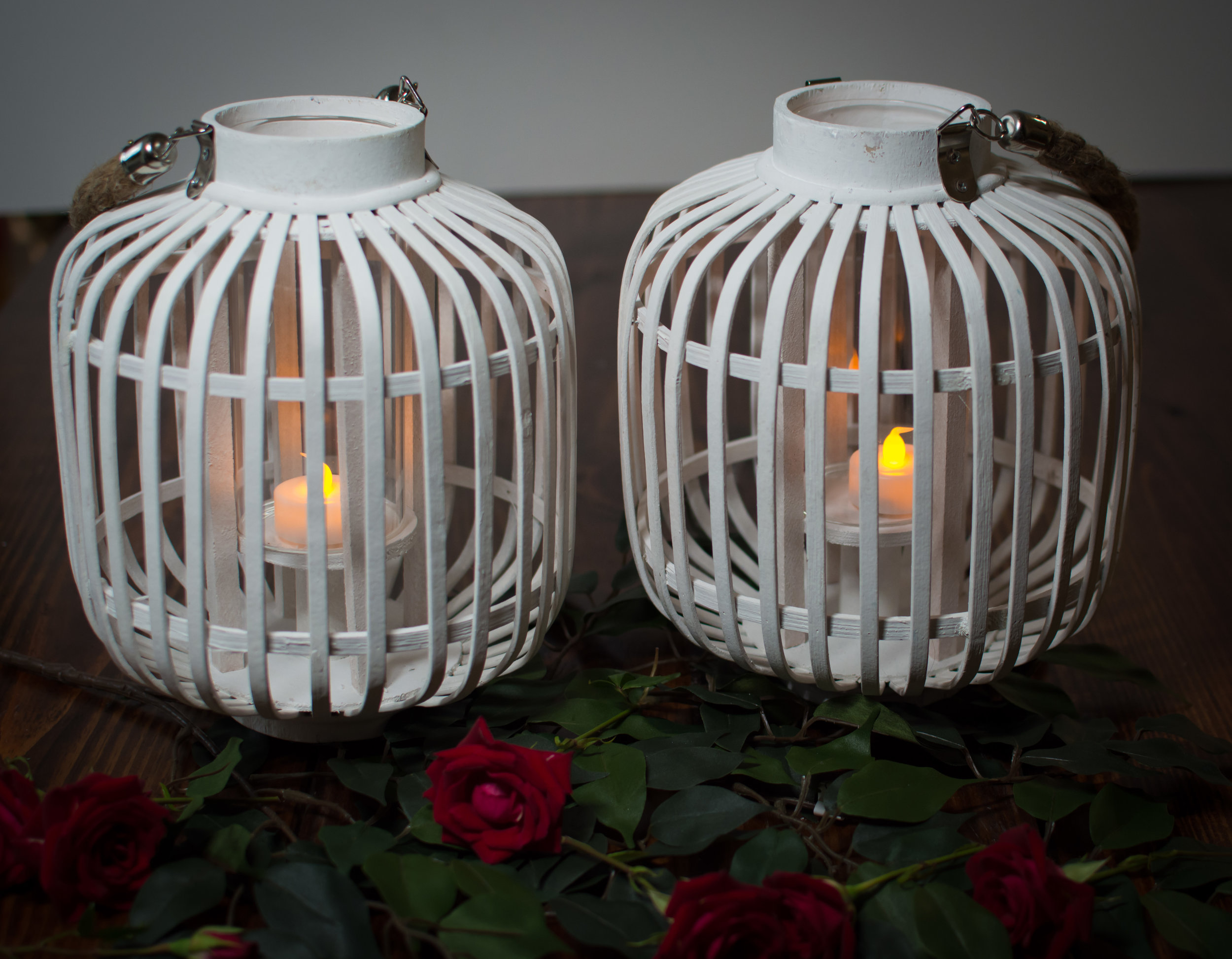 Set of 2 round white lanterns with candleholder   Price: $14.00/ $7 Each  Inquire about quantity and availability
