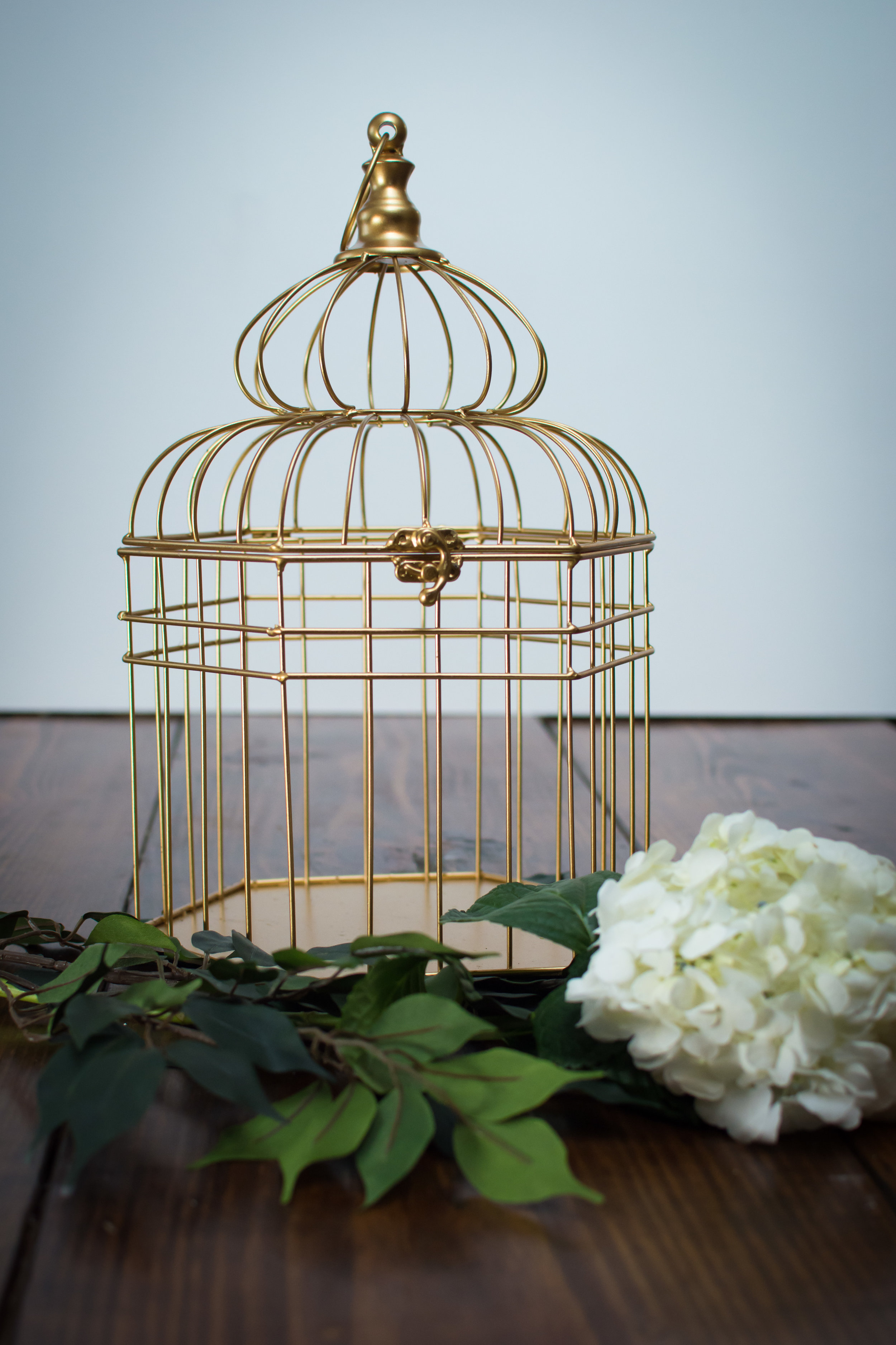 Gold birdcage   Price: $8.00  Inquire about quantity and availability