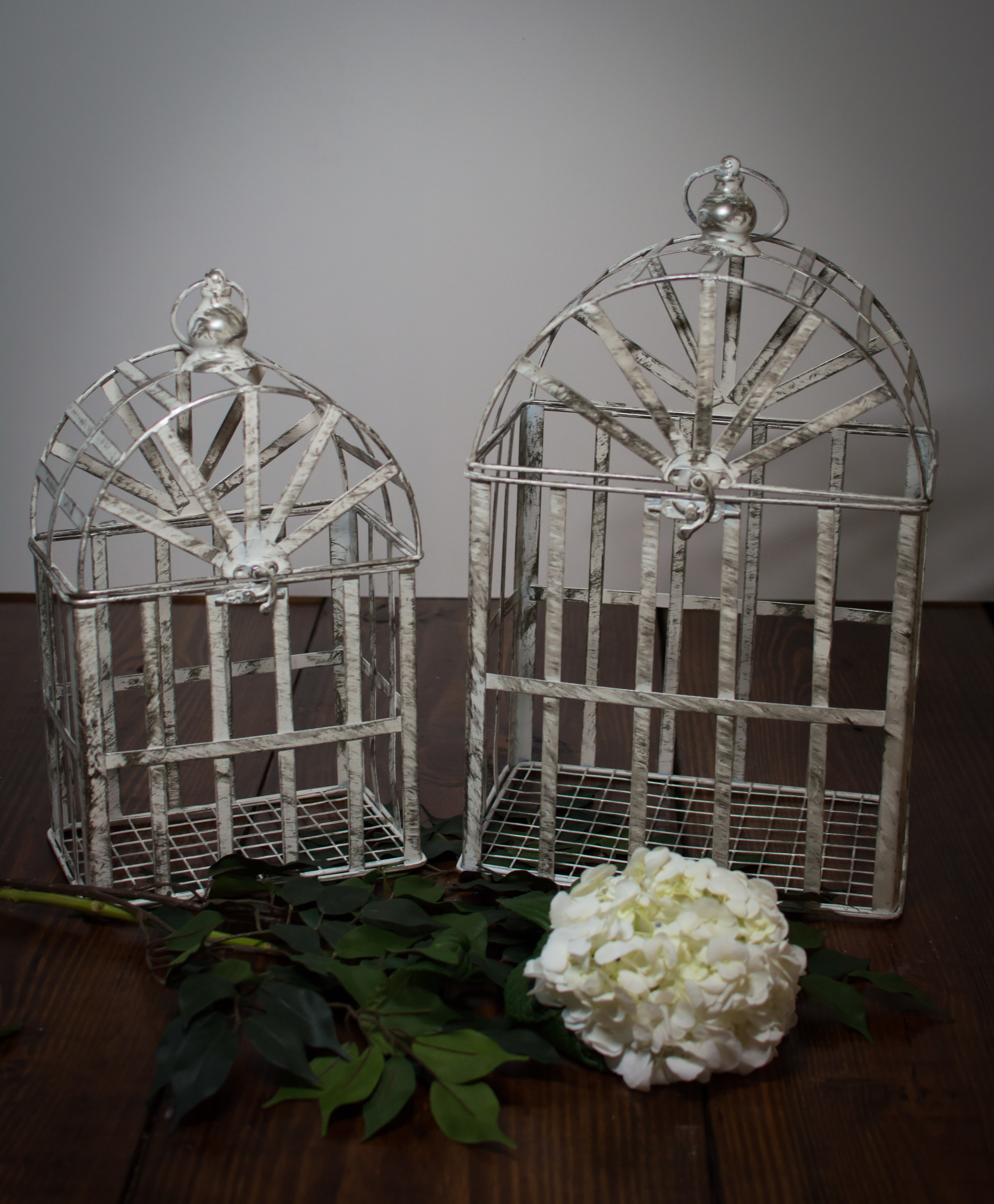 Set of 2 distressed white birdcages   Price: $22.00/ $12.00 large, $10 Small  Inquire about quantity and availability