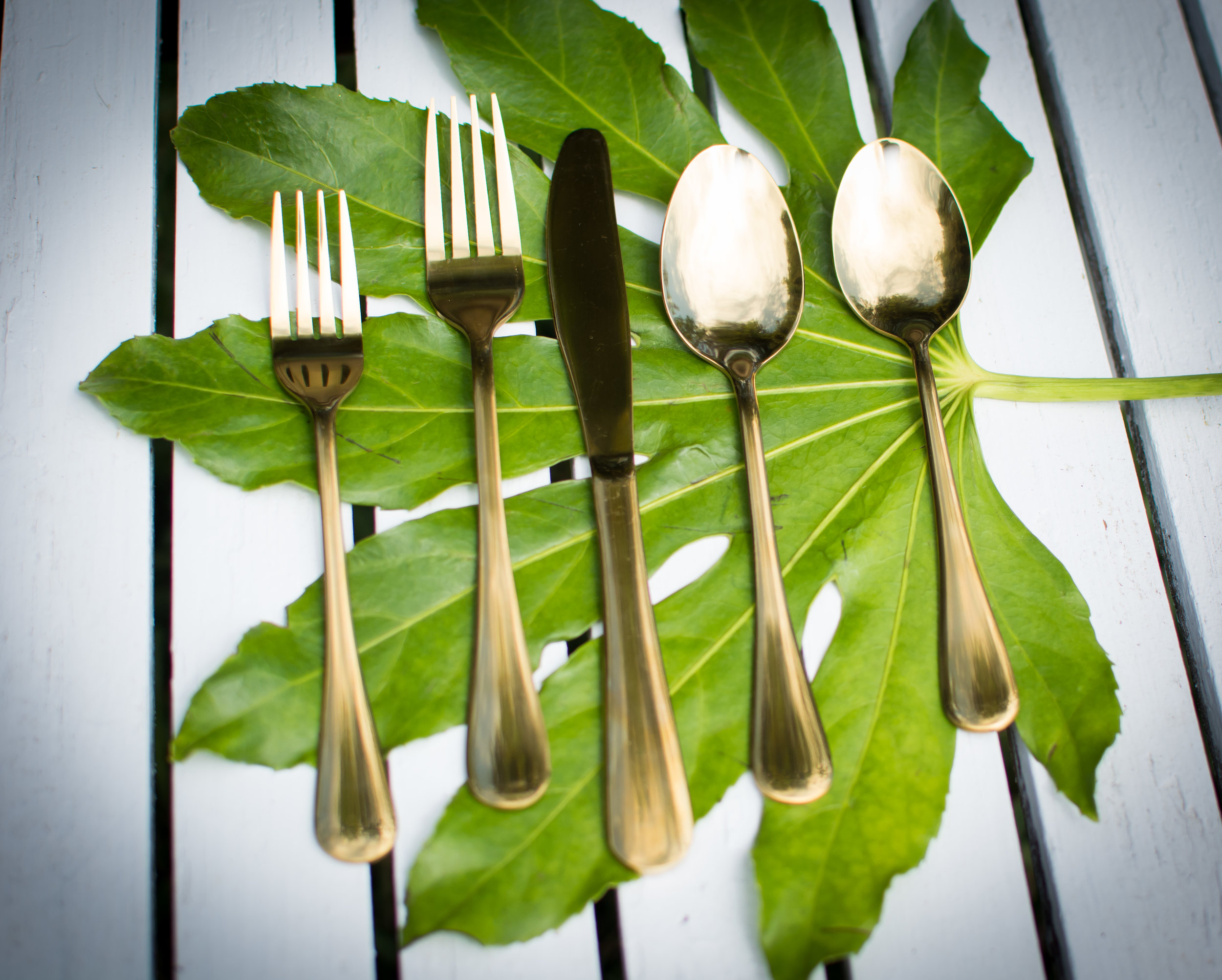 gold flatware   Salad fork, dinner fork, dinner knife, soup spoon, desert spoon  $.80 Per Piece  Inquire about quantity and availability