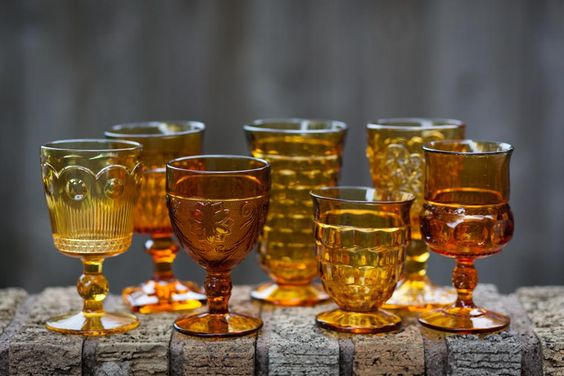 Amber goblet   Size: 12 oz  Price: $1.75  Quantity Available: 150  **MISMATCHED GLASSWARE, DIFFERENT HEIGHTS AND STYLES