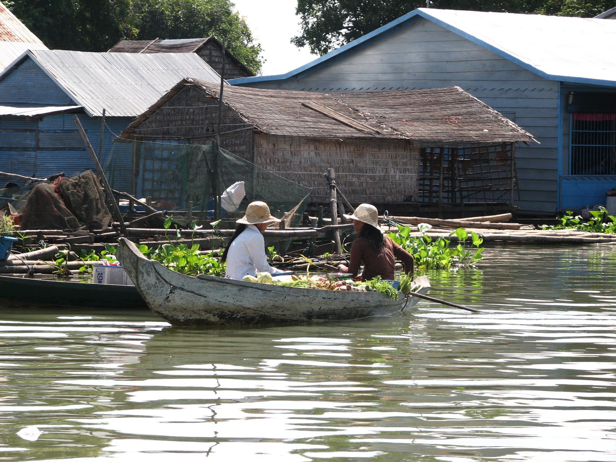 Women in boat with vegetables, Prek Toal