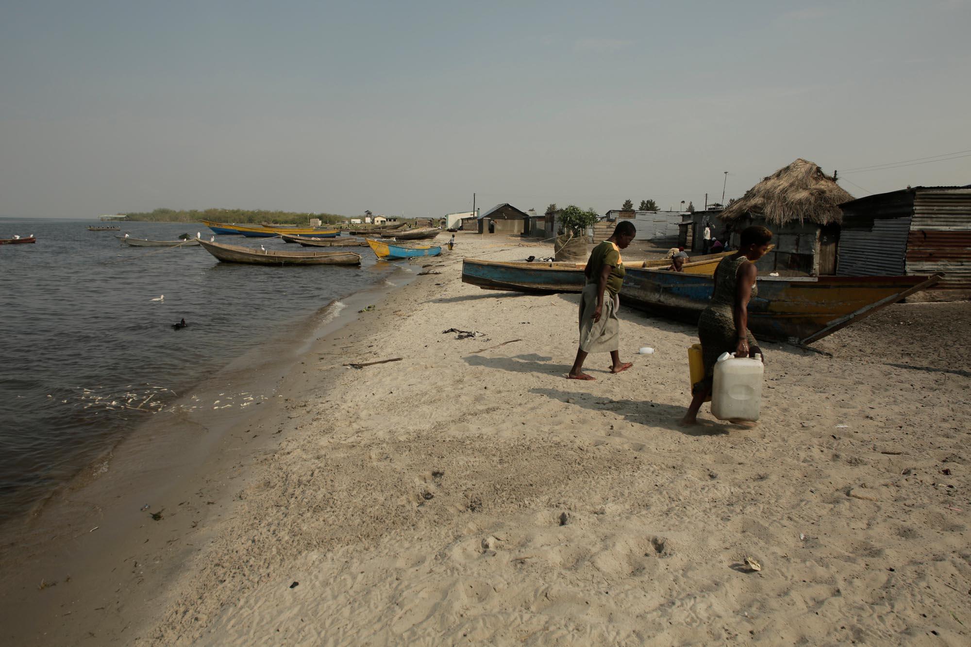 collecting water at Kachanga village, Lake Victoria, Uganda