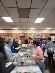 The Progreso Latino staff serve a delicious breakfast to community members. - Green Acres Cafe of 2131 Plainfield Pike in Johnston RI provided the warm meal.