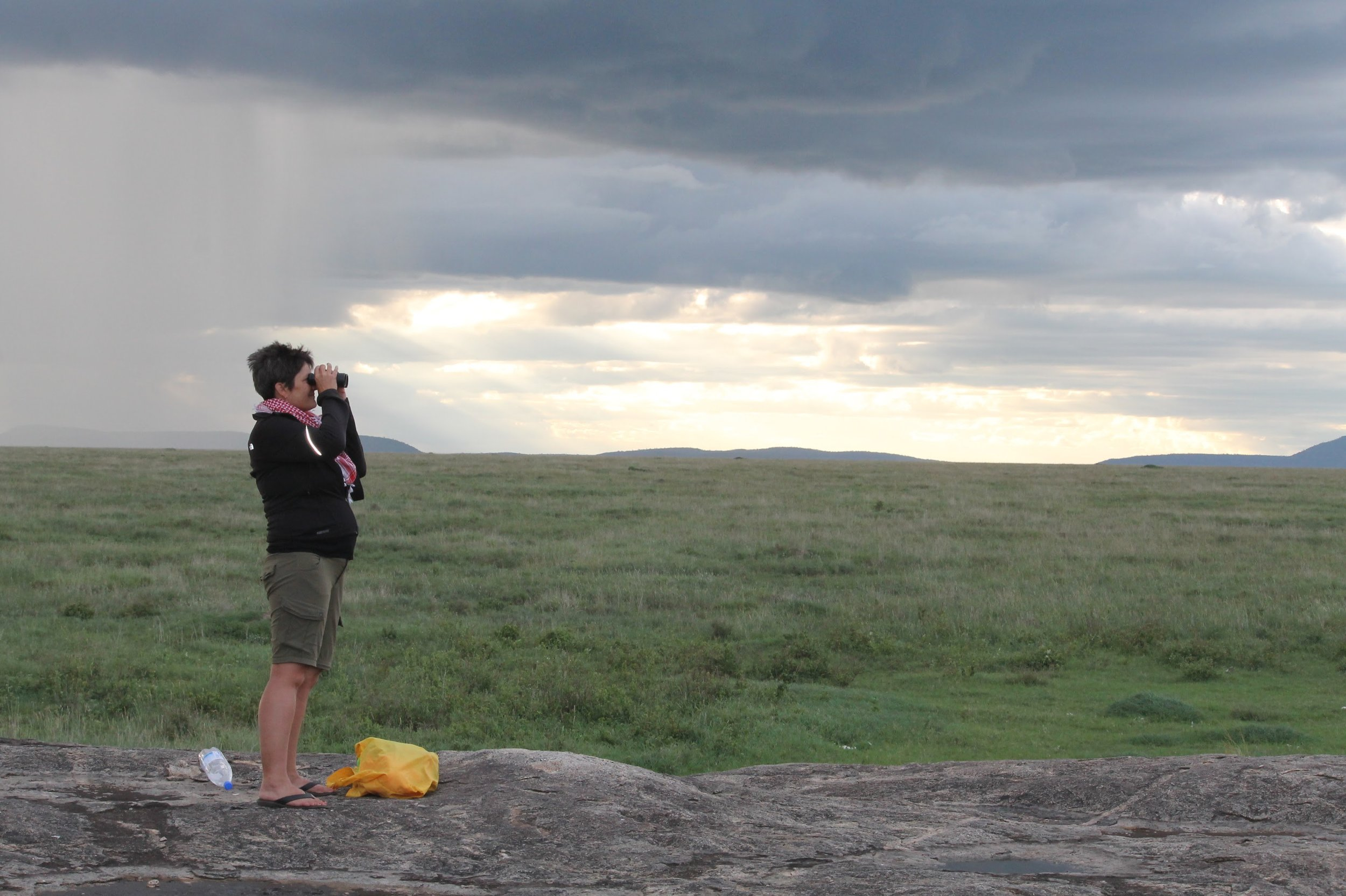 On the Serengeti, pondering just how vast it and the world are.