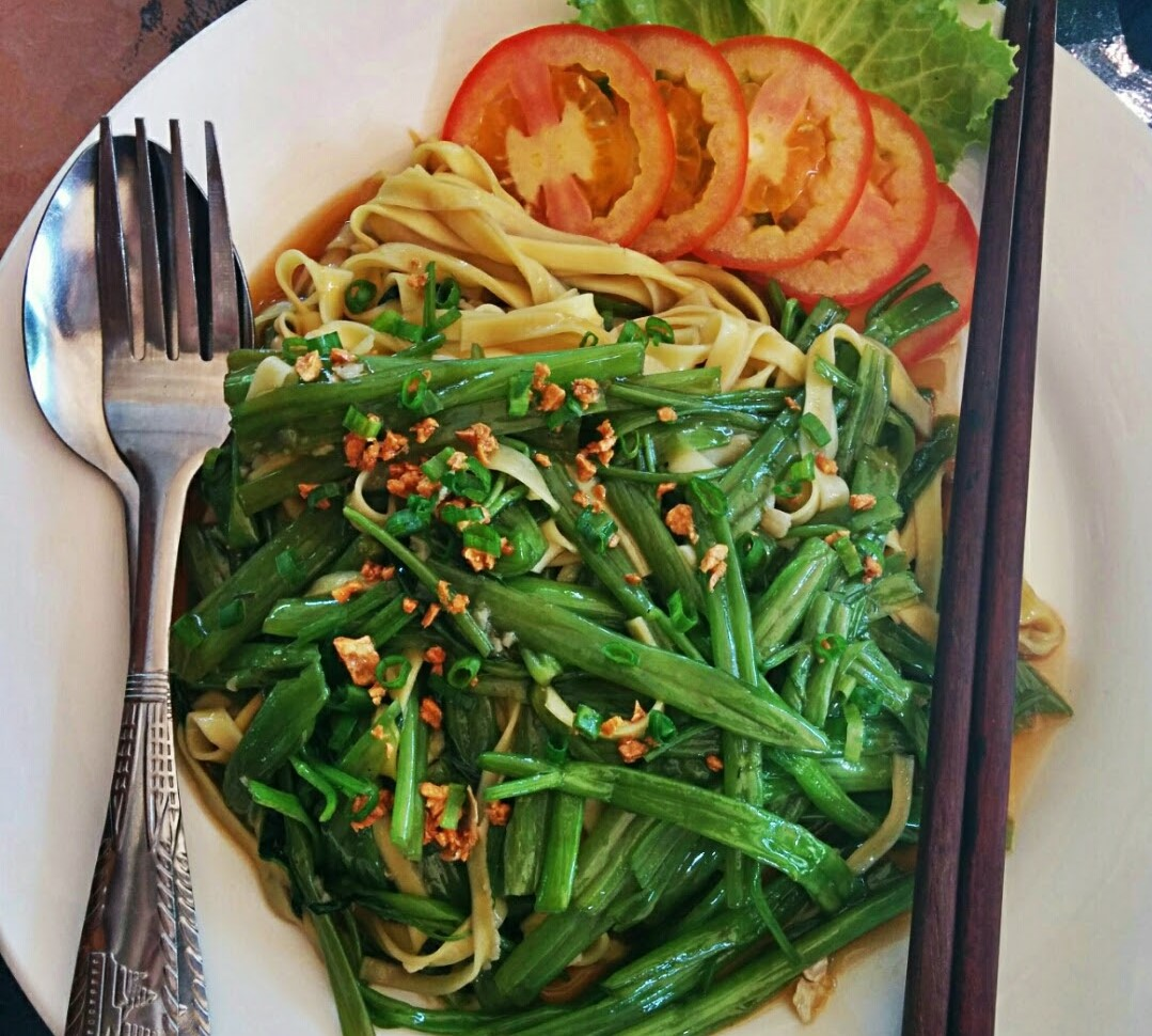 In Cambodia I dove into this dish of Stir-Fried Morning Glory. Don't you want to as well?