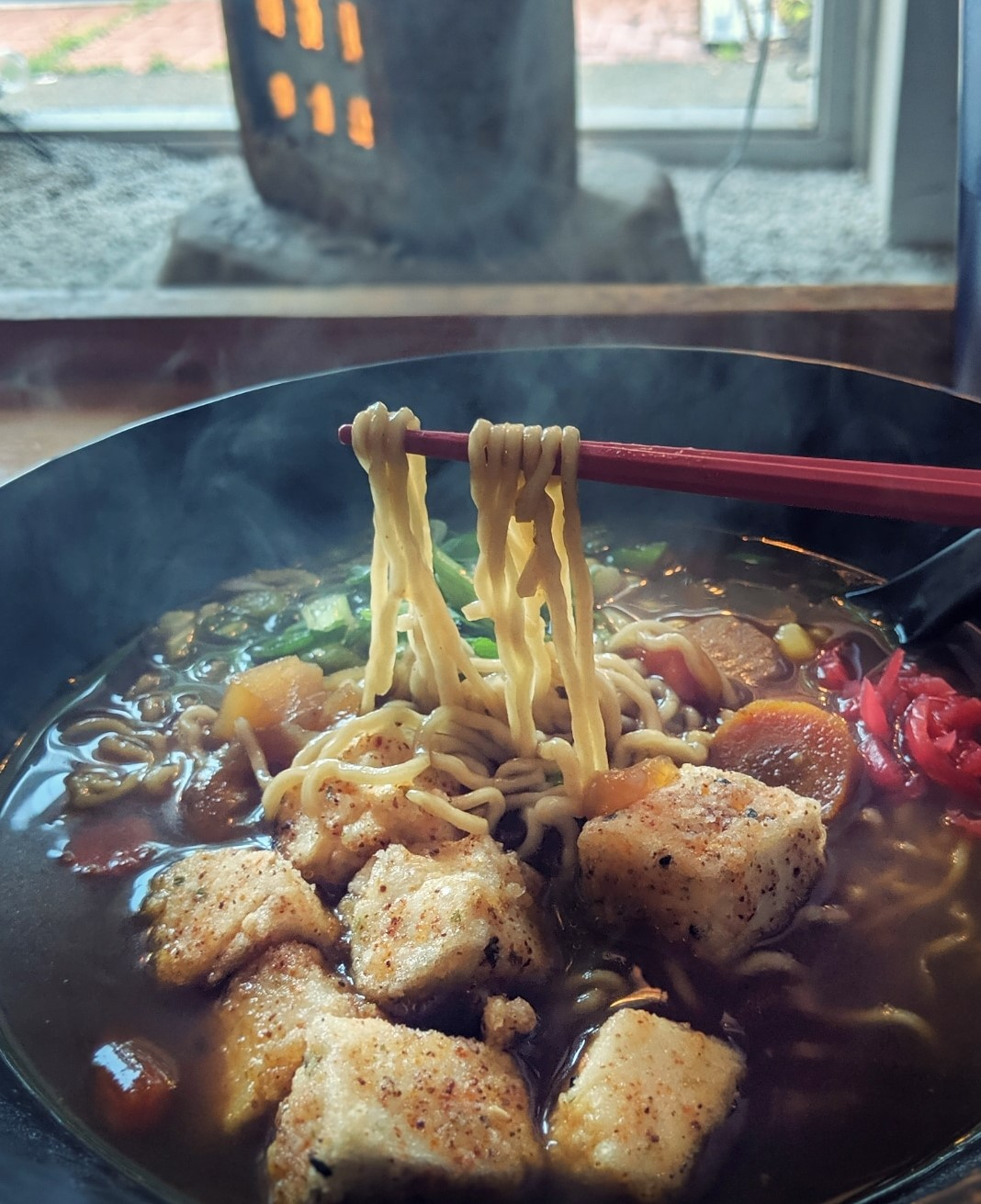 Japanese curry ramen with fried tofu was spicy, full of noodles and flavor at  SATO Ramen .