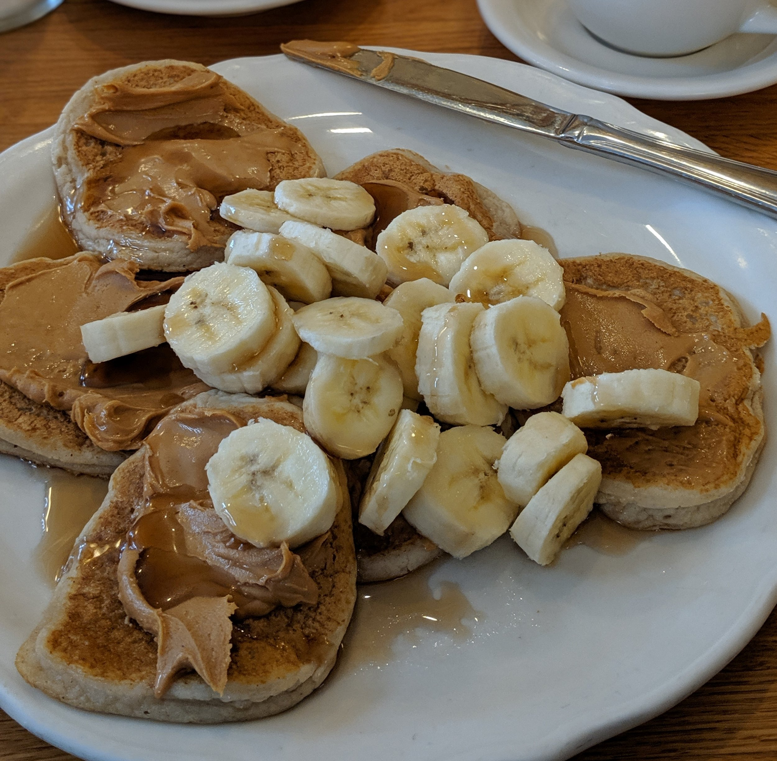 Peanut butter and banana smothered all over the top of these vegan pancakes at  Original Pancake House,  where I was very surprised and happy to see them on the menu!