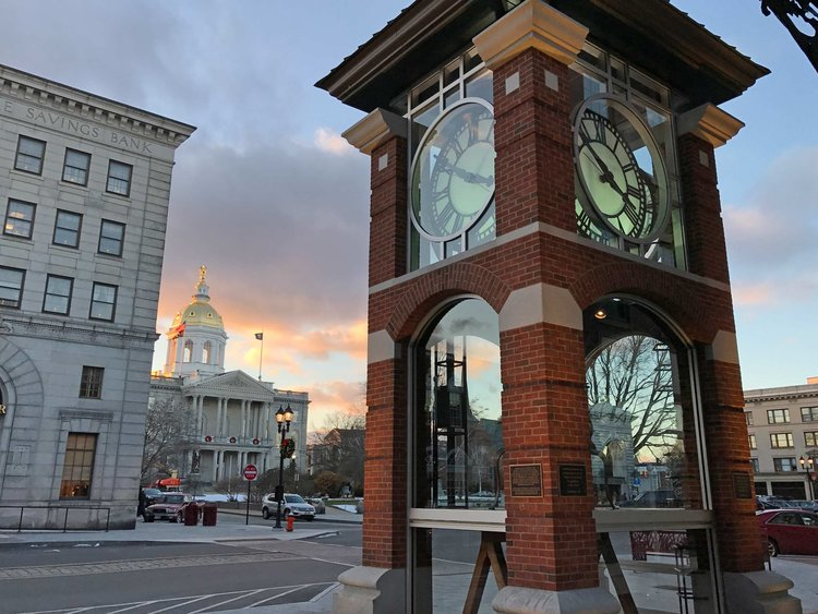 City-of-Concord-clock-tower-and-New-Hampshire-State-House.jpg