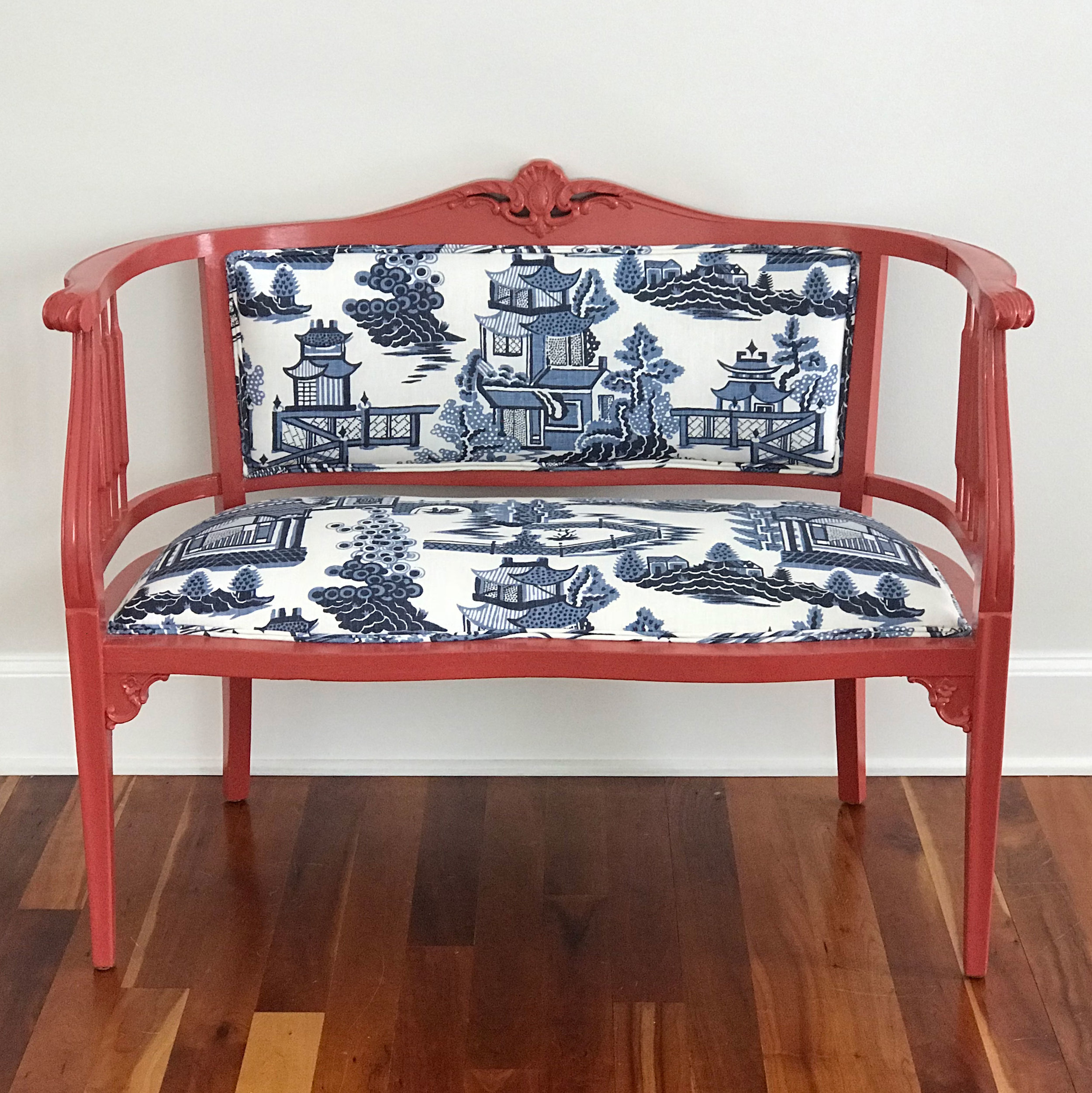 Beautiful antique bench painted in a vibrant color, paired with reupholstery in a classic chinoiserie fabric