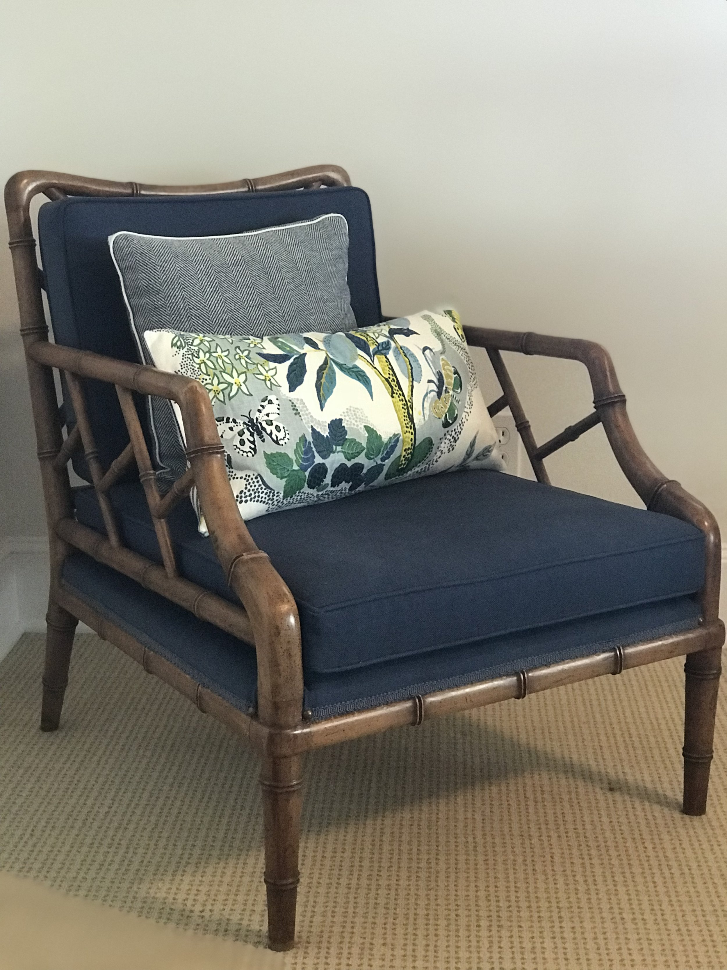 Vintage bamboo chair reupholstered with a classic navy fabric and custom accent pillows