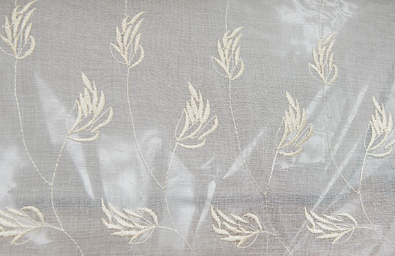 "TULIP   IVORY        100% POLYESTER                                 110"" WIDE - WASHABLE                                 EMBROIDERY  SHEER"