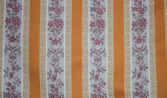 "LESSIRE   ORANGE        100% POLYESTER                                           108"" WIDE - WASHABLE                                          DECORATION & DRAPERY                                                   MADE IN ITALY"