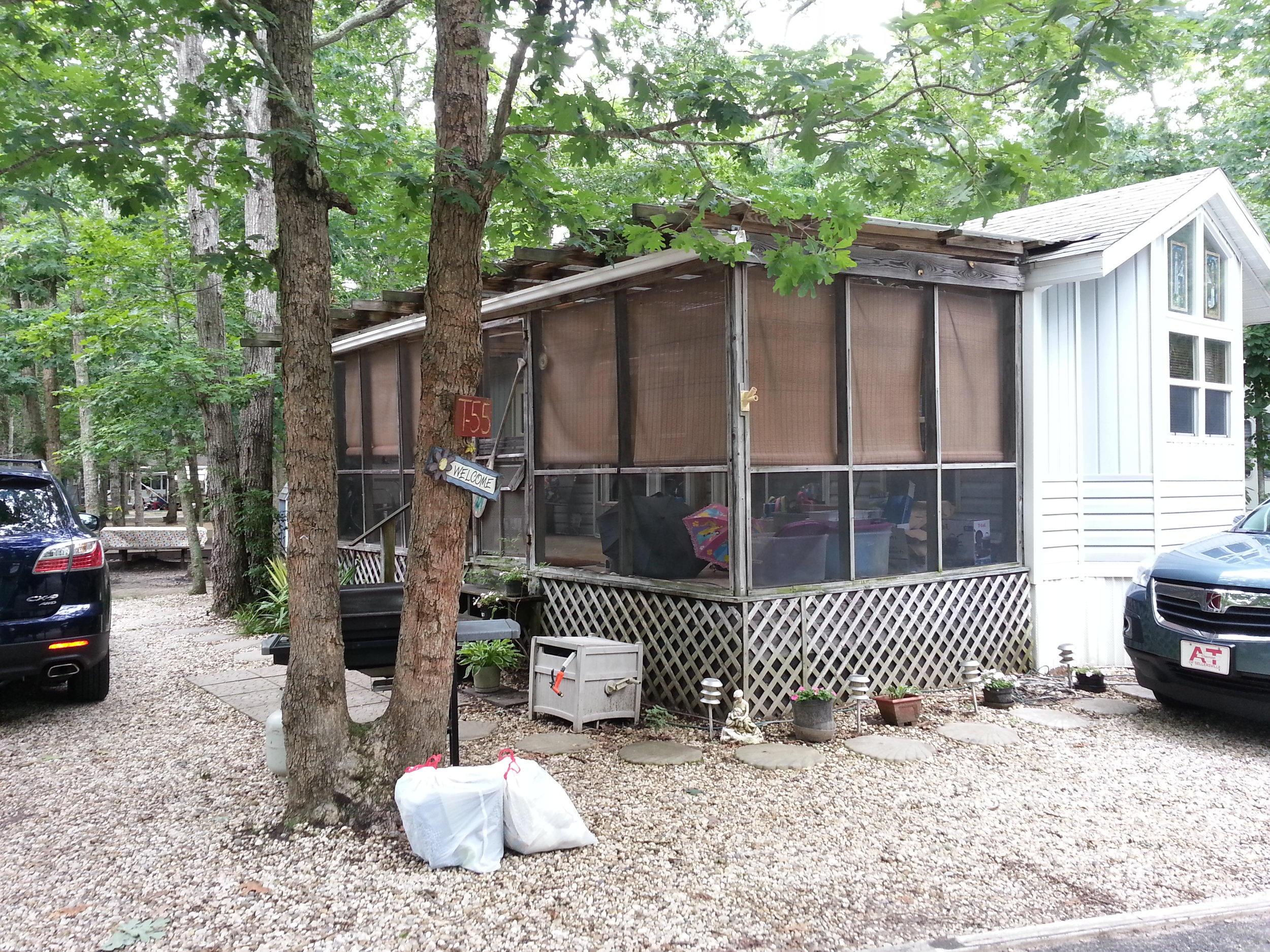 terri feralio - vacation cottage front porch before.jpg