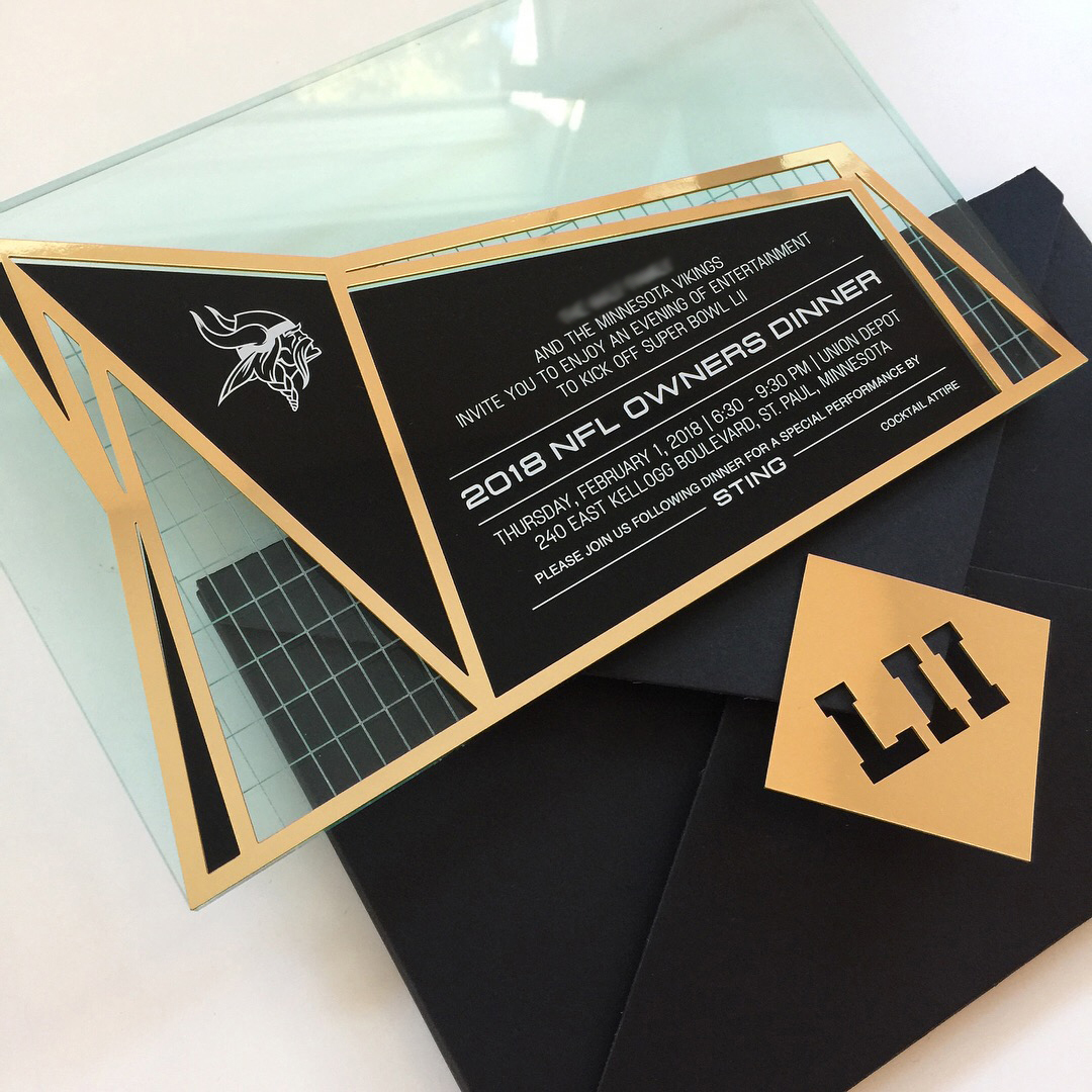NFL  \\ Cheering that the day has come for us to share the invitation we designed for the NFL Owners Dinner at the Super Bowl this year! Inspired by th Vikings USBank Stadium (the stadium was designed to look like a Vikings ship), we etched into glass and mounted with laser cut Chroma.