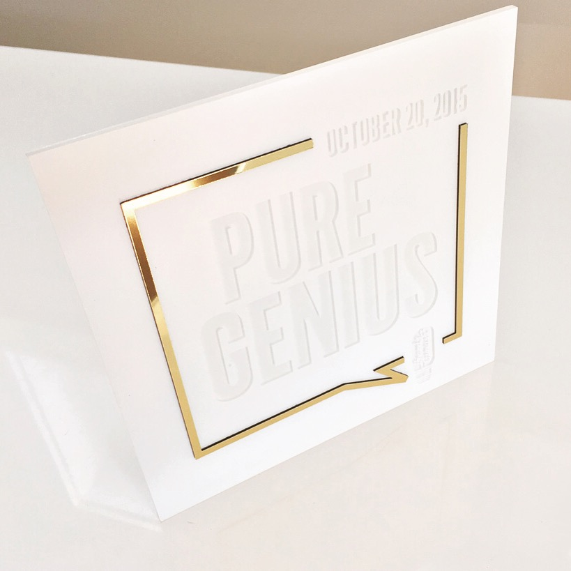 Adweek\Brand Genius  \\Pure genius. Honored to produce the Adweek Brand Genius invitations for a second time. The award is the marketing industry's highest honor recognizing the most inventive, ambitious and successful brand-building efforts.
