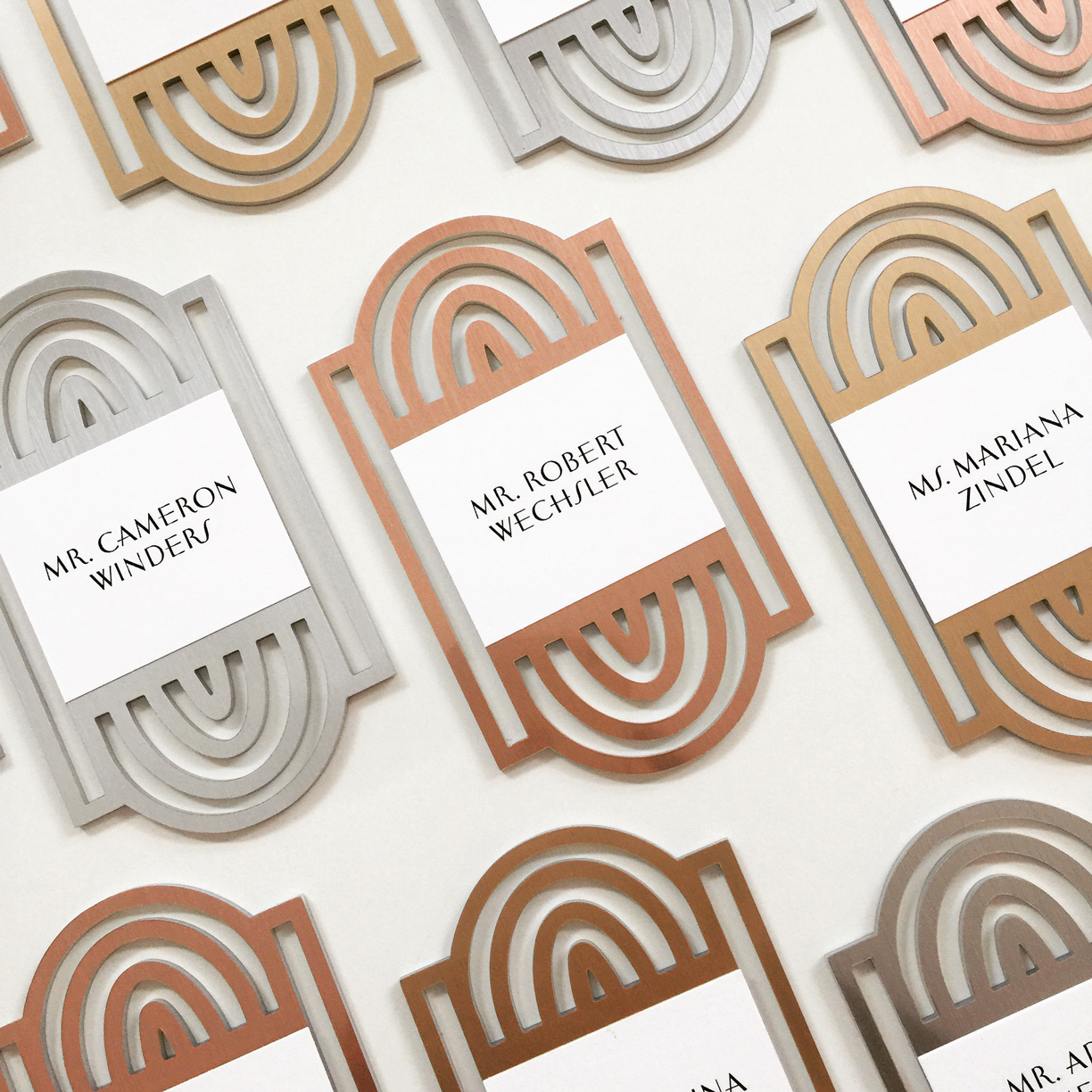 Seagram  \\ Metallic three ways continued! The escort cards for this birthday trifecta alternated in color by guest. Laser cut Chroma in brass, platinum and rose gold.
