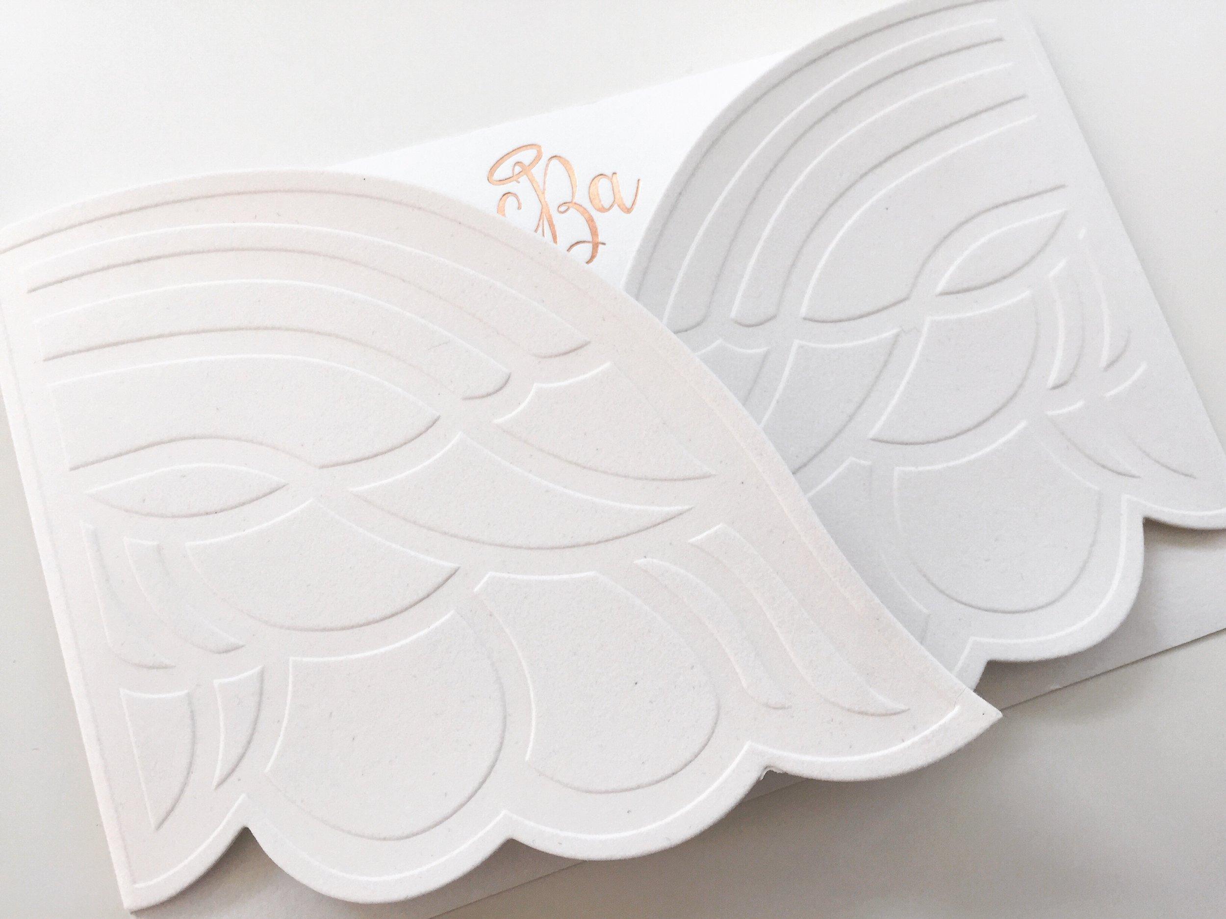 Whitney   \\Nestling in embossed velvet angel wings.