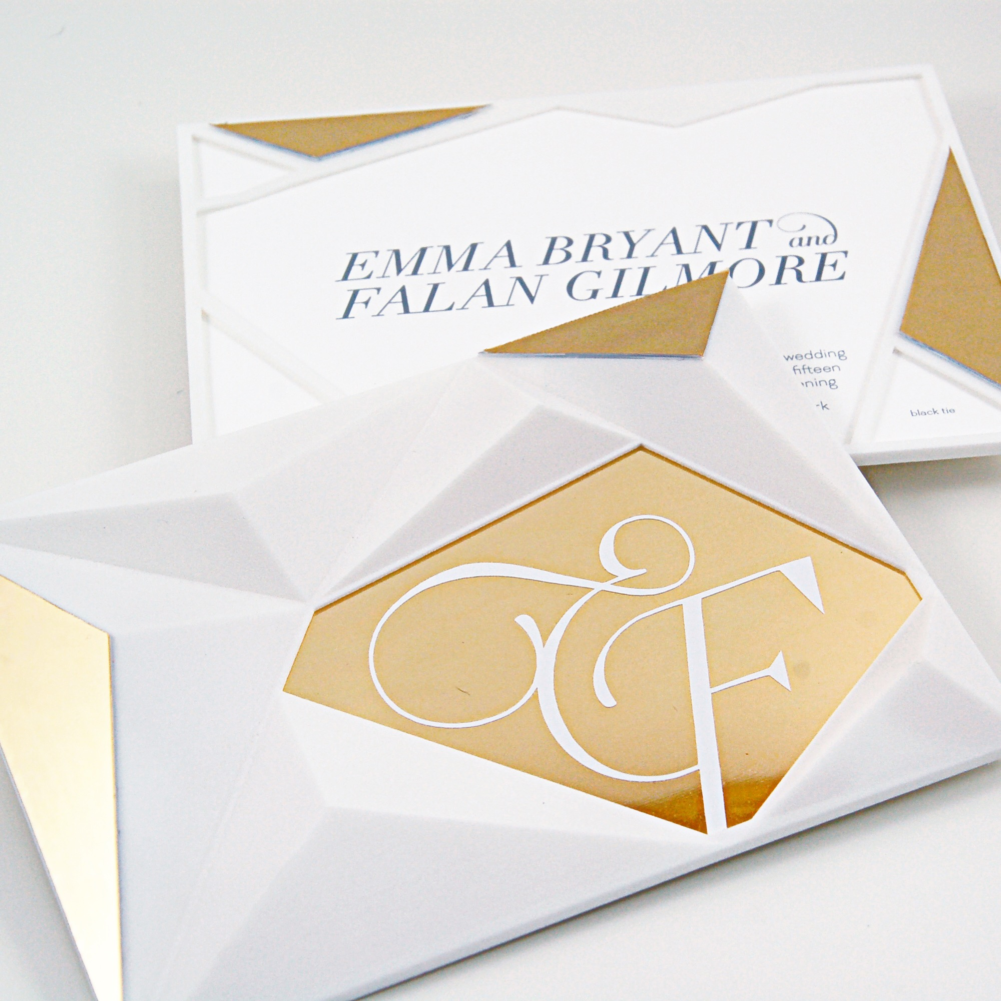 Emma & Falan  \\Our first 3D-printed invitation! Peaks of the printed piece with a gold Chroma invitation slipped inside.
