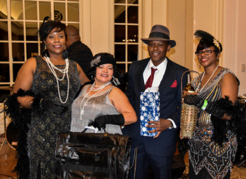 Winners of the Best Dressed Roaring 1920's theme holding their prizes, with APC Executive Director Candice Hillman.