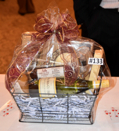 """""""A Day at the Park"""" Basket: Two piece Pineapple stopper and coaster gift set from The Bombay Company, a bottle of Chardonnay, two wine glasses and a wine stopper, a Hickory Farms Summer Beef Sausage, Jalapeno Cheddar Cheese, and Hickory Farms pineapple honey mustard made this basket a top seller!"""