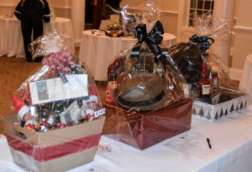 """Just a few of the gift baskets at the Silent Action. to the far left, """"A Suite Stay"""" Basket included a one-night stay at the Residence Inn by Marriott and a one-night stay at Springhill Suites by Marriott, a bottle of Sterling Sauvignon, candy and elves from """"Elf on the Shelf."""""""