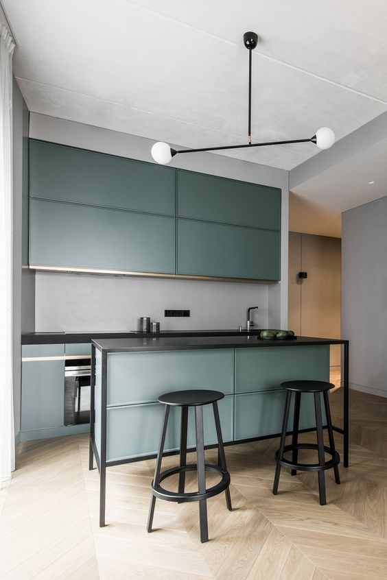 This isn't very earthy, but it's a good example of using metal on the island as the support. I would change a few things in here to make it a little more inviting. Maybe a deeper cabinet tone, or the addition of stone backsplash.