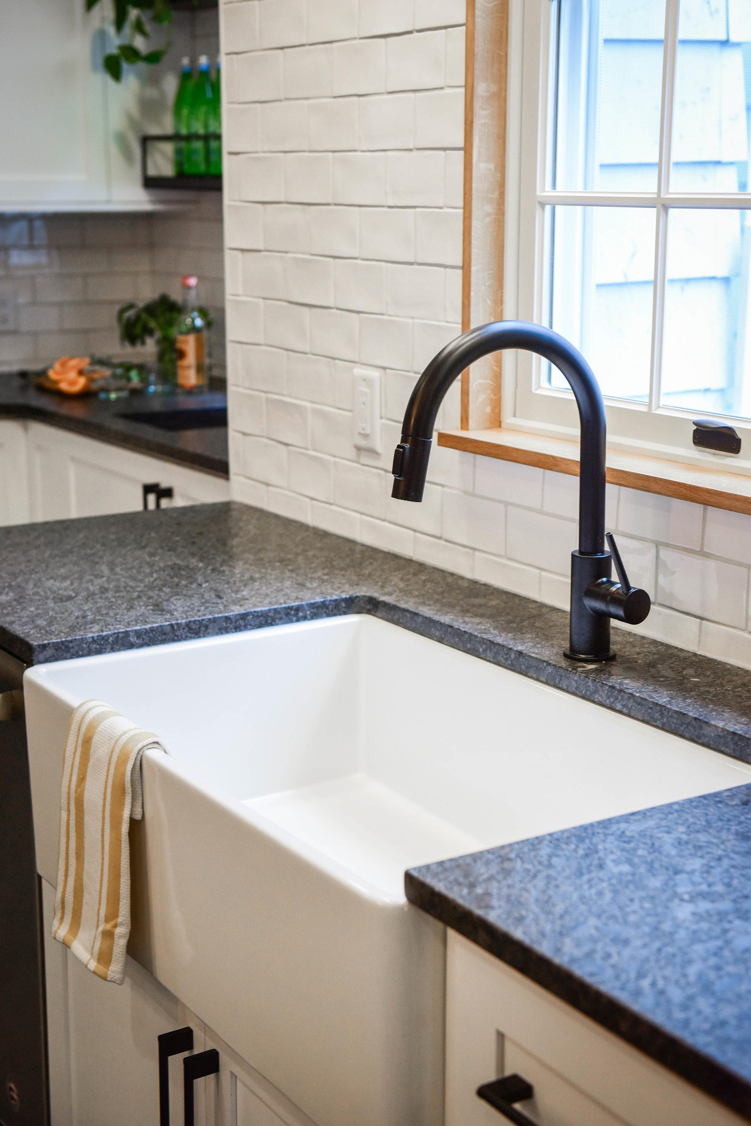 farmhouse sink black faucet.jpg