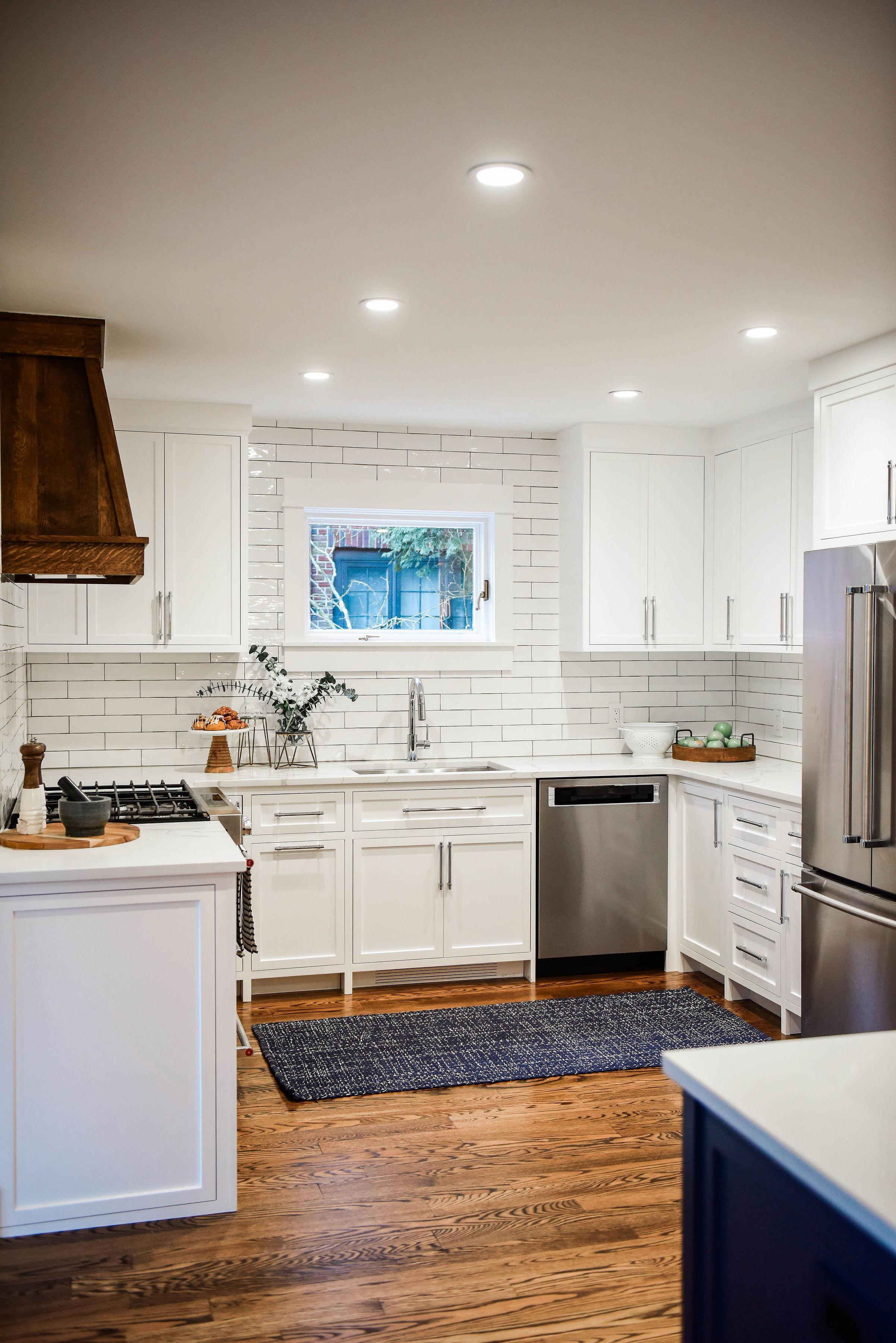 white kitchen inset cabinets subway tile.jpg