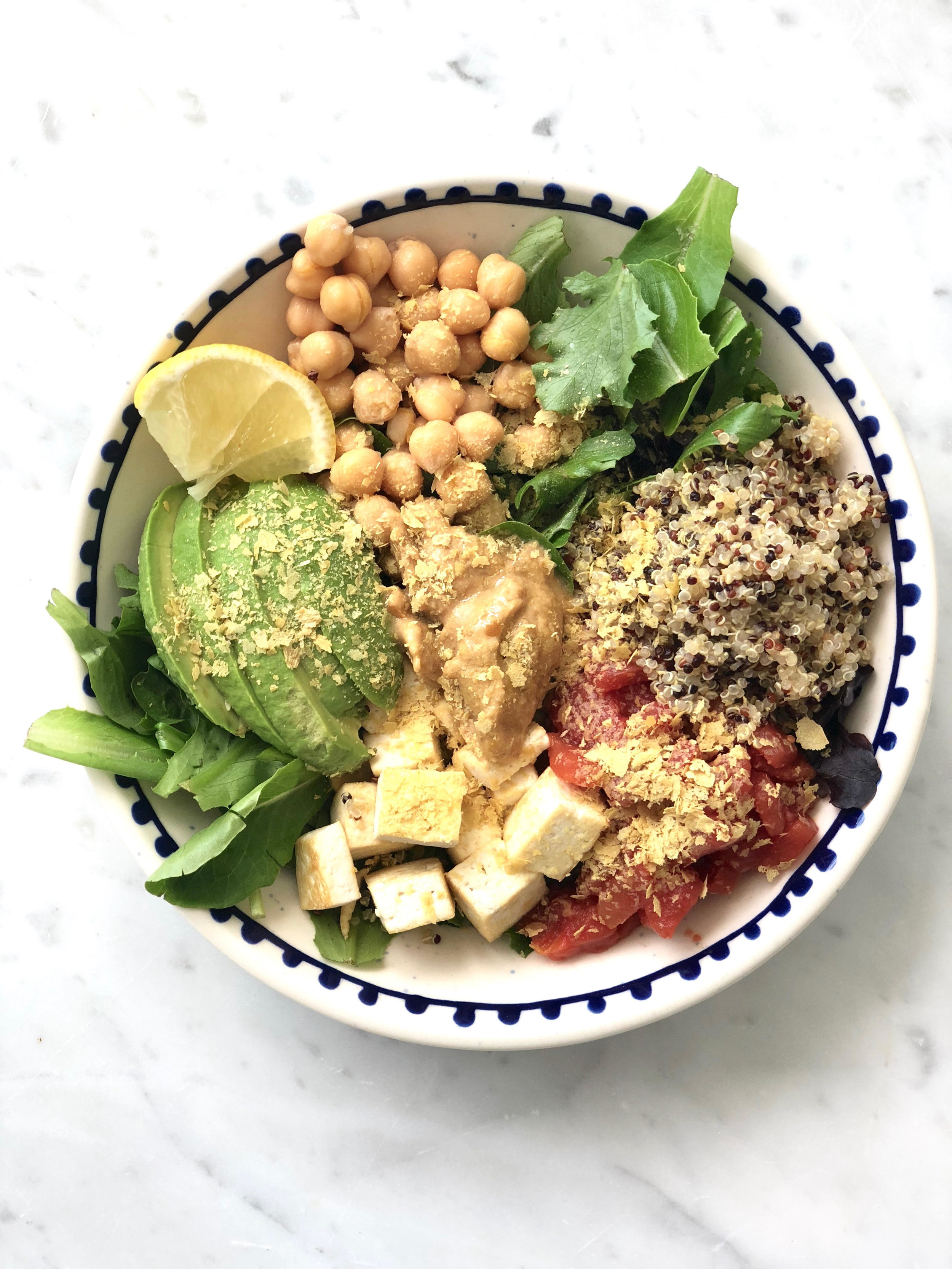 - Mixed greens, quinoa, chickpeas, tomatoes, tofu, tahini, avocado, nutritional yeast and lemon