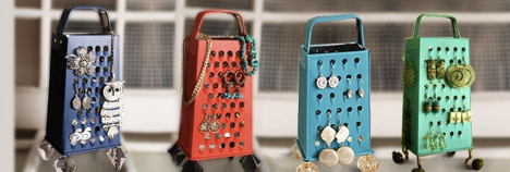 Hang a flat grater to your wall, or for 4x the storage, grab a stand up grater and decorate it like a Christmas tree with your earrings!