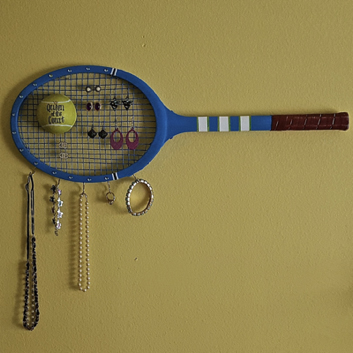Tennis rackets are essentially the frame and mesh listed above, but it's pre-made for you! If you want to spruce it up, consider painting the racket or adding hooks to the bottom for more storage.