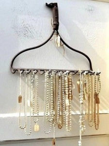 A metal rake can add a rustic feel to your decor while acting as a line of hooks for your necklaces and bracelets.