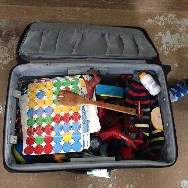 A three-year-old packs. #justtheessentials