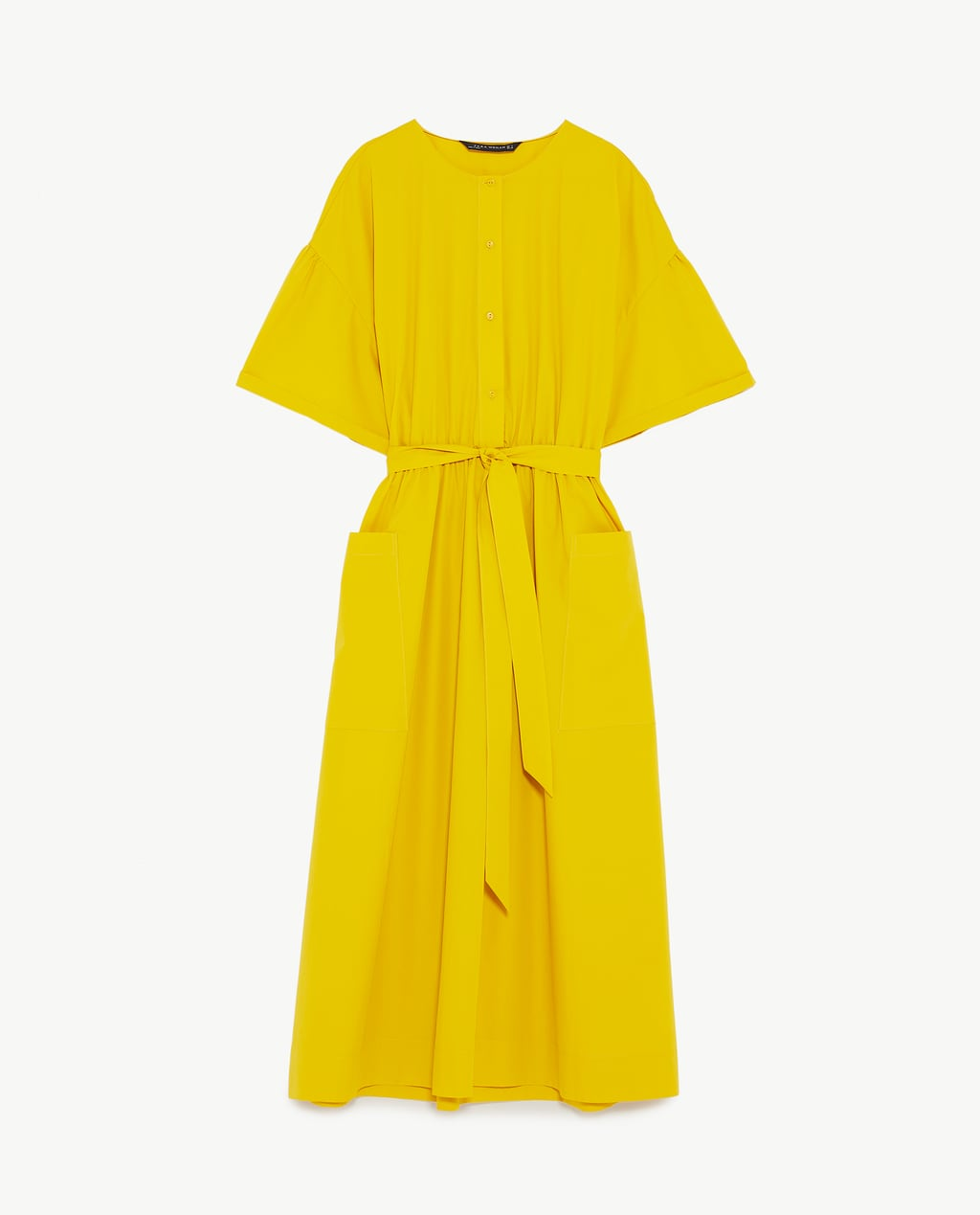 - Midi dress with round neckline and short turn-up sleeves. Elastic waist with tied belt detail. Wide A-line skirt with patch pockets on the front. Button fastening in the front.