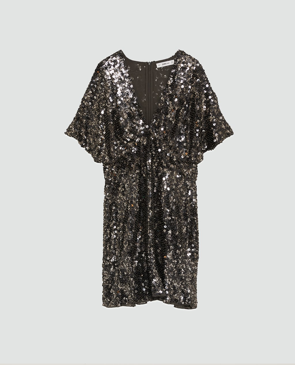 - Short flowing dress with a V-neckline and short sleeves. Features zip fastening in the back hidden in the seam.