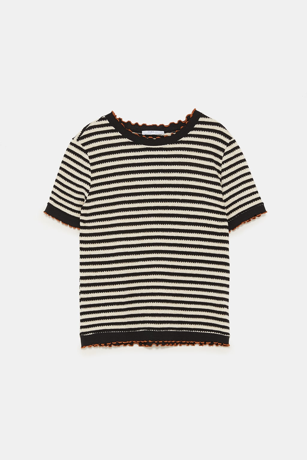 - Round neck short-sleeved sweater. Ruffly ribbed trim with contrasting piping. $29