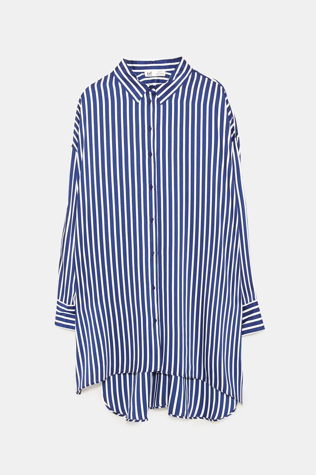 - Asymmetrical shirt with long sleeves with buttoned cuffs. Front button closure. Side slits. $39