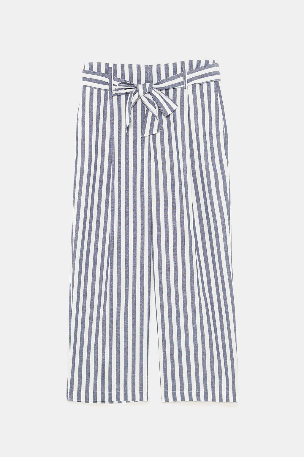 - High waist pants with self belt. Front pleats. Side pockets and false back welt pocket. Front zipper and metal hook closure. $39