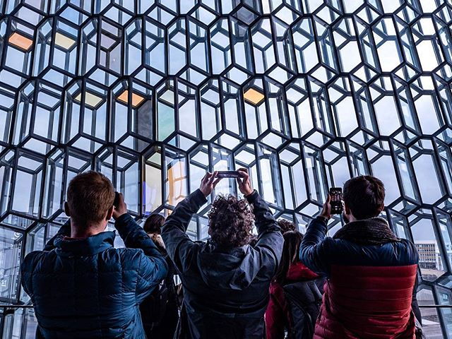 I walked into the grand entry of the concert hall and all I could do was look up. Panes of yellow, orange, blue glass spilled like a waterfall from its' peak to the floor. Harpa reflects Iceland's landscape, and in addition to the landscape, is one of the most spectacular architectural sites to see. . . . #iceland #harpa #waterfall #musichall #concerthall #music #photography #architecture