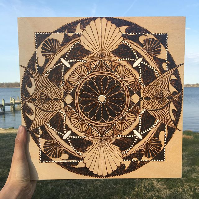 A couple months ago I put down my paint brush in favor of a pyro pen. My creative urges come in kinda intense waves and I can barely eat or sleep until I see it through. Four wood burned panels later and I still love the process. 🔥🔥🔥🔥#pyrography #woodburning #mandala #angelfish