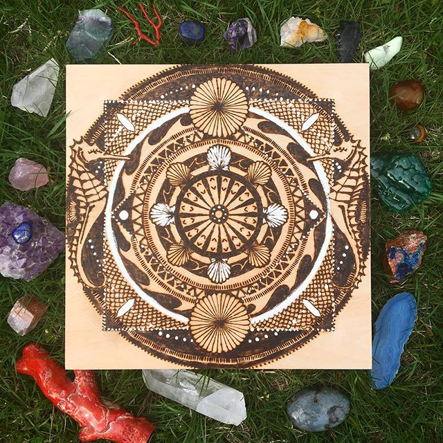 Did this piece turn out as I planned? No, they rarely do. Sometimes I think my work has a mind of its own. Pictured with some of my favorite healing crystals. ❤️🧡💛💚💙💜 #pyrography #woodburning #mandala #seahorse #healingcrystals #coral